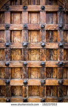 Old castle door texture with faded wood.