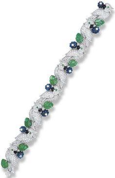 Cartier diamond, emerald, and sapphire bird bracelet