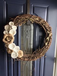 Grapevine wreath with floral and burlap hand rolled flowers. by GunnyandGrove on Etsy https://www.etsy.com/listing/224121837/grapevine-wreath-with-floral-and-burlap