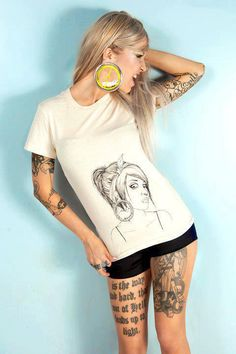 LIKE + REPIN AWAY! Look close. Sara Fabel with amazing gauges. There's a hampster wheel in her tunnels. Also phenomenal tattoos and ink. Support Tattoos + Piercings at Work: www.facebook.com/SupportTattoosAndPiercingsAtWork