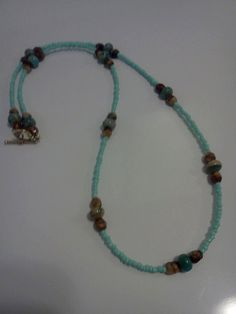 Blue Necklace with Glass Brown Beads and Terquoise Glass Beads  by laurenengler2012, $20.00 available for purchase @ http://www.etsy.com/shop/laurenengler2012