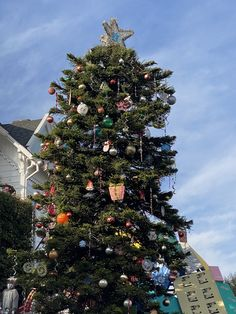 Visiting the massive, decorated tree on 21st Street is a part of our Christmas that endures in 2020.
