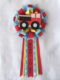 Fire truck Baby Shower Corsage Find me at iogtreasures.etsy… I can create a custom corsage for you to match your event. Boy Baby Shower Themes, Baby Shower Balloons, Baby Boy Shower, Baby Shower Decorations, Shower Centerpieces, Baby Sock Corsage, Firefighter Baby Showers, Fire Truck Nursery, Beautiful Baby Shower