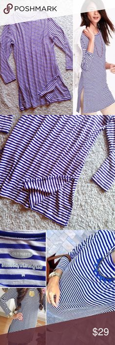 Tunic Blue + White from Old Navy Striped. Long sleeve. Split sides. Tunic length. Soft and stretchy. In some of the pictures, it looks more purple than it actually is. The color is closest to a cobalt blue with white stripes. It will completely cover your backside, so it's a perfect Top to wear with leggings☺️ Tops Tunics