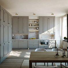 Shaker cabinetry, grey tones, marble splashback.