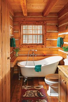 Rustic Bathrooms A claw-foot tub highlights the historic feel of this cabin in Montana.