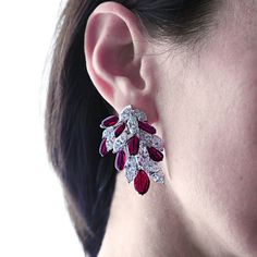 A waterfall of exceptional D colour marquise #diamonds and pigeon blood pebble #rubies for our Cascades #earclips ❤ In total, 16 pebble #pigeonblood rubies weighing 36.31 #carats, together with 24 #marquise diamonds weighing 33.19 cts. Set on #whitegold. #worldofreza