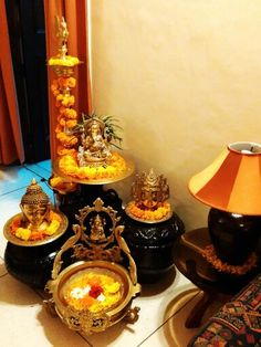A traditional indian antique brass puja basket is filled for Simple diwali home decorations