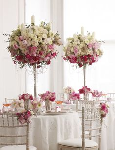 Roses and Peonies in white and shades of pink sit high on grand candelabras #wedding #weddingflowers #bridesmagazine #whiteroses #pinkpeonies