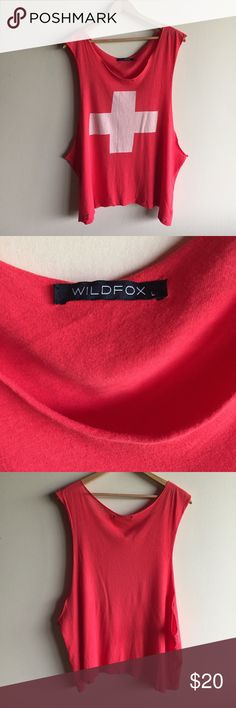 """Wildfox red lifeguard muscle tank top Cute oversized tank from Wildfox..also great as a swim cover up! Has a small hole in the side seam as pictured. Otherwise great condition! Measures 29"""" long. Wildfox Tops Muscle Tees"""