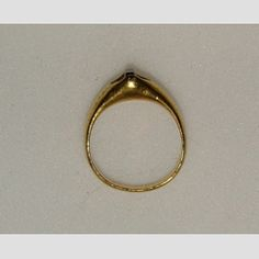 Ring  Probably Italy  14th century  Gold stirrup ring, the angular bezel hollowed out and set with a diamond so cut at the back as to project the image of a cross by reflected light  17.12 mm internal ring diameter; 9.72 g weight