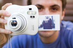 This camera prints out a credit card size photo after you take a picture. A modern Polaroid. WANT!
