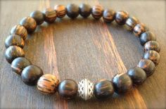 • Mens Beaded Bracelet made with Dark Palm Wood and Silver Celtic Bead • • Palm wood is a coconut timber, brown with deep brown flecks.