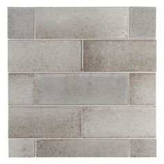 "Lava Calda 3"" x 9"" rectangle fields in rustic griege, set in an offset brick pattern on a 14"" x 14"" display board"