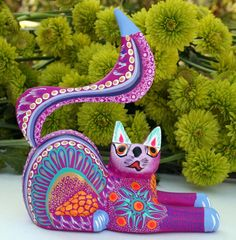 By Luís and Margarita Sosa ~ This cute magenta cat wood carving was hand carved and hand painted in the famous carving village of San Martin Tilcajete, Oaxaca, Mexico.