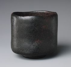 Raku Tea Bowl Tea bowl, ca.), (Japanese, Japan Rough clay covered with a dull black glaze; three spur marks of iron supports (Raku ware) Tea bowl Raku Pottery, Thrown Pottery, Slab Pottery, Japanese Ceramics, Japanese Pottery, Wabi Sabi, Ceramic Bowls, Ceramic Art, Glazed Ceramic