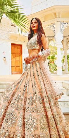 30 Exciting Indian Wedding Dresses That You'll Love Indian wedding dresses are very beautiful. Usual indian bridal dresses made of chiffon or silk and adorned with elaborate embroidery, red or gold color. Indian Fashion Dresses, Indian Bridal Outfits, Indian Gowns Dresses, Indian Bridal Fashion, Dress Indian Style, Indian Designer Outfits, Indian Bridal Wear, Designer Dresses, Desi Wedding Dresses