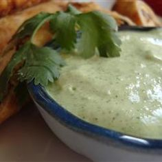 """This cilantro cream sauce can be used as a dip, or as a sauce for fish or chicken. My husband eats it on everything he can consume! Taste and add additional seasoning if necessary. tomatillo sauce is usually spicy, so be prepared! Cilantro Cream Sauces, Cilantro Sauce, Guacamole Sauce, Cilantro Dressing, Lime Dressing, Mayonnaise, Chutney, Sour Cream, Pollo Tropical"
