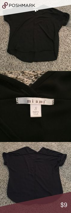 Francesca's Miami black high low top v neck Good used condition. Very minimal hole pull where tag is on back. Last photo. Francesca's Collections Tops Tunics