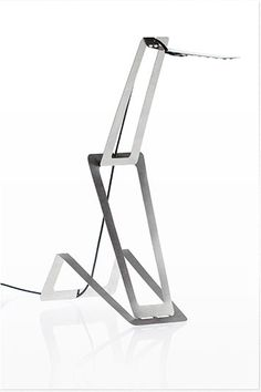 Sleek slim minimal thin collapsible steel lighting cut from a single sheet of metal for minimal waste. Well thought out indeed… I like it. The illumination system of Flaca, based on LED technology, require only 6 watts.