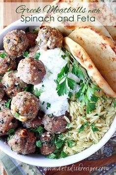 Greek Turkey Meatballs with Spinach and Feta Recipe | Ground turkey meatballs are loaded with feta cheese, spinach and Greek herbs and spices. Delicious served with orzo or flatbread. #meatballs
