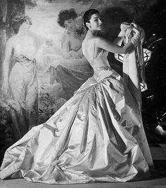 Model Dorian Leigh, taffeta gown by Jean Patou. 1955