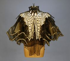 """marylibra: """" PINGAT JET BEADED BUTTERFLY EVENING CAPE Maison Emile Pingat A. Walles & CieCream satin with chiffon shoulder drape beneath two layers of stiffened black net decorated as butterfly wings with silver sequins and faceted jet beads,. 1890s Fashion, Victorian Fashion, Vintage Fashion, Historical Costume, Historical Clothing, Chiffon Shoulder, Floral Vintage, Vintage Butterfly, Antique Clothing"""