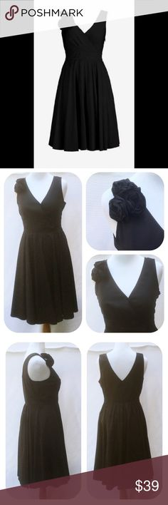 """New Eshakti Black Fit & Flare Dress XL 18 New Eshakti black fit & flare dress. Size XL 18 Measured flat: Underarm to underarm: 40"""" Waist: 34-39"""" Length: 42""""   Eshakti size chart for size XL 18 bust: 43 ½"""" Surplice w/ inner snap closure & inverted bust pleats, banded waist w/ elastic smocked back waist for perfect fit & flare, side hidden zipper. Flared skirt, side seam pockets, 3 removable rosettes at shoulder. Cotton, woven poplin, pre-shrunk & bio-polished, no stretch. Machine wash. New w…"""