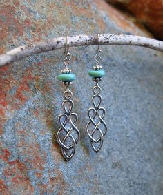 Take a look at this Aqua Magnesite & Silvertone Boho Twist Drop Earrings today!
