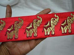Red Elephant Embroidered Ribbon Trim Sewing Fabric Trim  You can purchase from below link or What's App no. is +91-9999684477. We also take wholesale inquiries   https://www.etsy.com/in-en/listing/574185693/red-elephant-embroidered-ribbon-trim