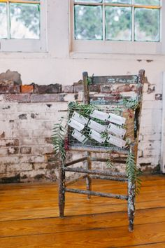 rustic metal escort card display #escortcards #rustic #weddingchicks http://www.weddingchicks.com/2014/04/09/illuminated-industrial-wedding-ideas/