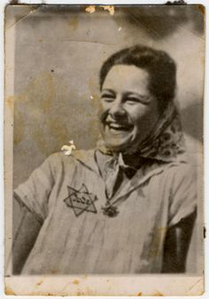 Close-up portrait of a Jewish woman with a badge and a broad smile in the Lodz ghetto.  Pictured is Henia Gorset, a member of Hanoar Hatzioni
