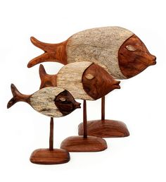 Hand-Carved Mozambican Sandalwood Fish. These rustic fish sculptures are skillfully created through a process of hand-carving and hand-sanding. Each fish incorporates the rough bark and inner wood of the sandalwood tree.  #africa #fathersday #fathersdaygifts #father #handmade #africansculpture  #uniquegifts  #sculpture #fairtrade #homedecor #handmadegifts #swahilimodern