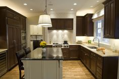 ivory subway tile with dark cabinets - traditional - kitchen - chicago - The Kitchen Studio of Glen Ellyn