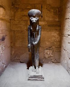 Statue of Sehkmet - the Egyptian goddess of war but also of healing.  Her breath created the desert.