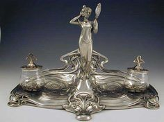 Silver-plated double inkwell with full figural Art Nouveau Maiden and wonderful floral decoration. Original engraved glass inkwells, Germany,  ca. 1905