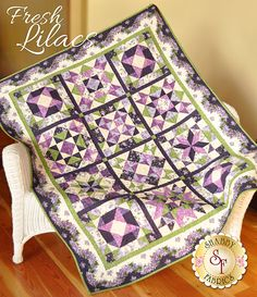 Fresh Lilacs Pattern: Bring your lilacs inside with the Fresh Lilacs quilt! This beautiful design features the Fresh Lilacs collection by Debbie Beaves for Maywood Studio. Finishing to 50