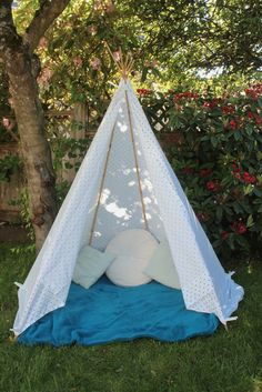 5 minute teepee.  Just need 6 bamboo poles, a king sized sheet and some clothes pins
