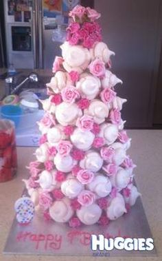 For my daughters 9th birthday party we created this tower. It is small meringues stuck to a cone shape to form the tower, decorated with fake flowers, huge hit with girls!