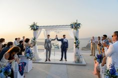 Dimitri and Mariano's Breathtaking Destination Wedding in Santorini! Capture by #Phosart See their story http://photographergreece.com/en/photography/wedding-stories/819-wedding-reception-party-at-santorini-gem