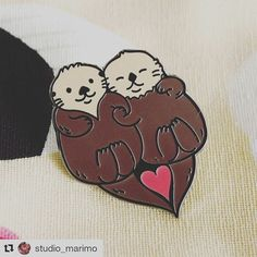 In love with this pin by #Repost @studio_marimo 😍❤💘 ・・・ ❤ Significant Otters Enamel pin. marimobuttons.etsy.com  #pin #enamelpin #lapelpin #pingame #otter #kawaii #love #studiomarimo #otters #animalsofig #love #lovely #lovebirds #pins #pin #pingram