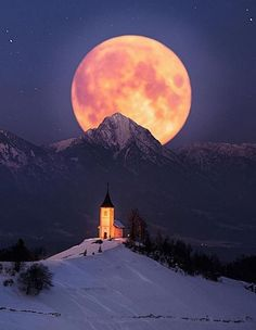 Epic moonrise over a humble church somewhere in Iceland ///