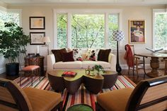 This modern cottage's eclectic living room was completed by Tommy Chambers Interiors. #luxeLA