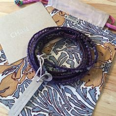 NWT Chan Luu Bracelet NWT Chan Luu Bracelet. Purple leather with purple and silver beads. Adjustable strap. Comes with bag. Chan Luu Jewelry Bracelets