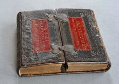 A Bible of 1756, which has been separated into two equal parts part way through the Book of Psalms. These have then been bound side by side, so that the second part opens back-to-front. The effect is of two separate books, bound fore-edge to fore-edge, on a common lower board, with separate spines. The front cover opens in two halves from the centre, rather like a cupboard