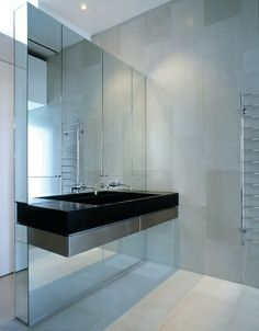 The clean lines are carried through into the bathroom.