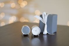 #25PerfectGifts: The inspiration for the Tube Clock and Speaker came from a simple, unlikely place: metal tube and extrusion ring: a metal tube and extrusion ring. The small tubular body sits on two peg legs, delivering superior style (and sound) to a desktop or other surface where space is limited.