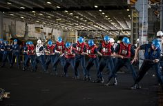 PACIFIC OCEAN (April 28, 2013) Sailors heave a line in the hangar bay of the aircraft carrier USS Nimitz (CVN 68) while conducting a replenishment at sea. Nimitz and Carrier Air Wing 11 recently left San Diego for a Western Pacific deployment. (U.S. Navy photo by Mass Communication Specialist 3rd Class Raul Moreno Jr./Released)