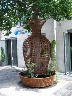 A bit at the bottom (to heavy looking) but I am really enjoy the over sized vase structure in general and the way that it looks on a line of street trees.