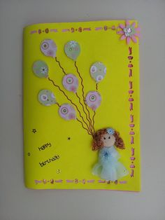 Birthday Card made from punched paper baloons some stickers and a doll!